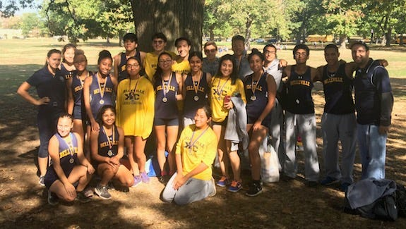 Belleville cross-country teams posing after competing at the Essex County Track Coaches Invitational.