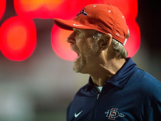 South-Doyle head coach Clark Duncan yells during the game against Bearden at South-Doyle on Thursday, Sept. 7, 2017.
