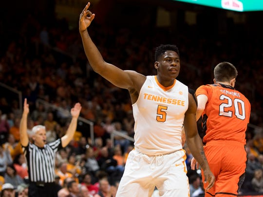 Tennessee forward Admiral Schofield (5) celebrates a three-pointer during Tennessee's basketball game against Mercer at Thompson-Boling Arena on Wednesday, Nov. 29, 2017.