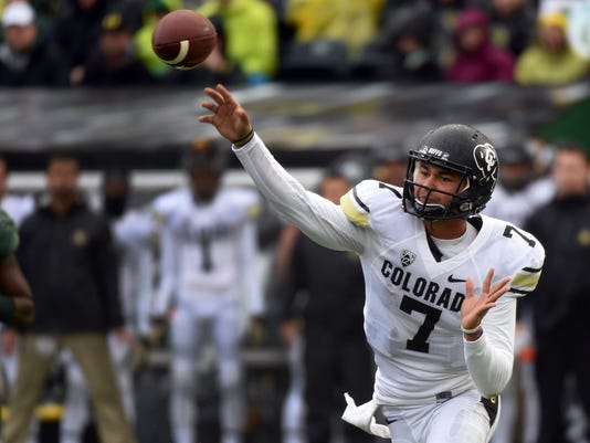 Colorado quarterback Jordan Gehrke (7) passes the ball during the first quarter of an NCAA college football game against the Oregon on Saturday, Nov. 22, 2014, in Eugene, Ore. (AP Photo/Steve Dykes)