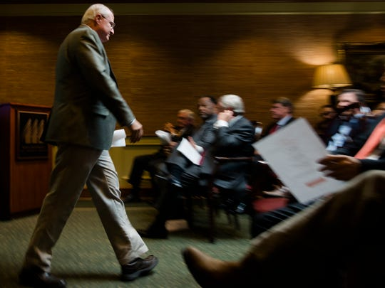 Les Massey, Whitfield Foods president, walks to his seat after speaking about the company at the 2014 Success Starts Here Industry Announcement on Tuesday, Dec. 16, 2014, at the Montgomery Chamber of Commerce in downtown Montgomery, Ala.