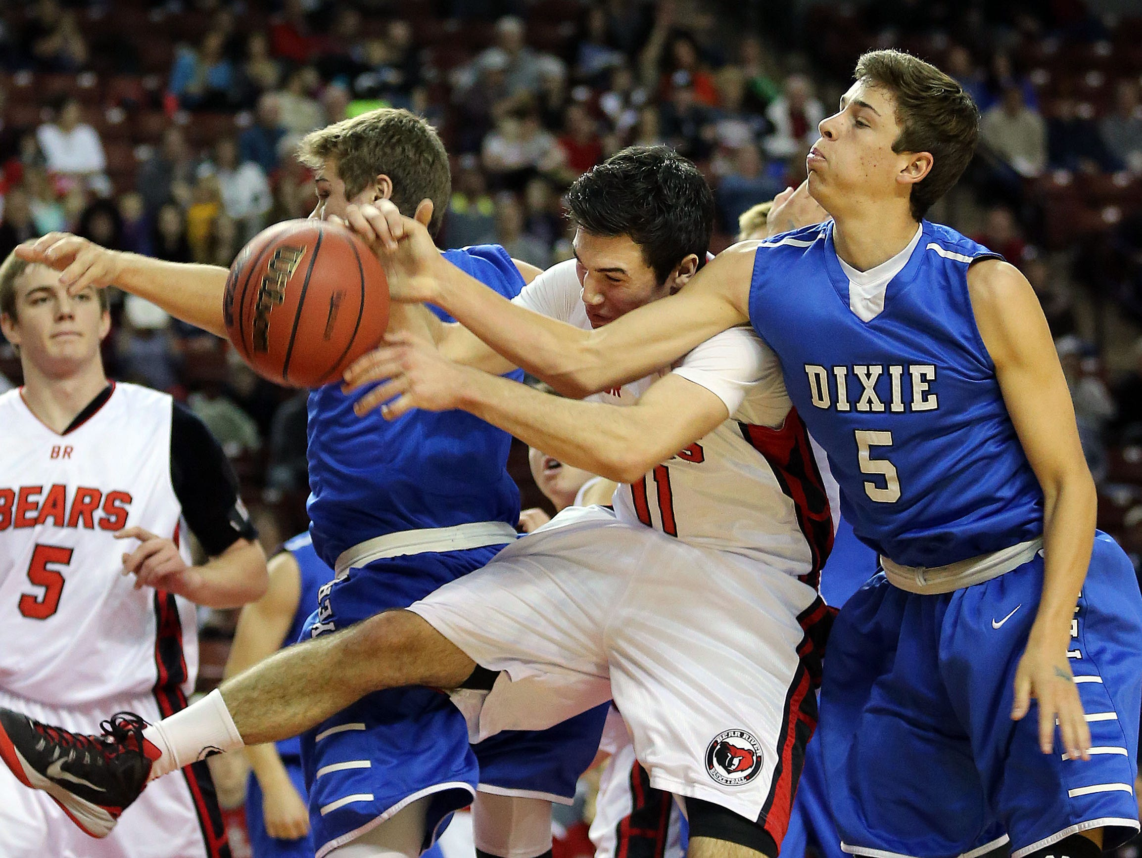 In one of the most exciting finishes in Utah high school basketball history, Tyler Bennett drained a 3-pointer at the buzzer to propel Dixie over Bear River, February 2015, West Valley City.