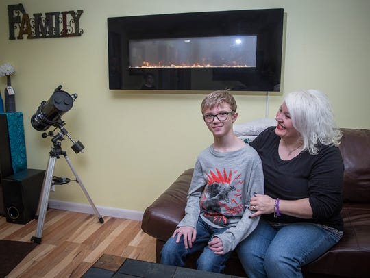 Devin Kidd with his mother, Amy, at their home in Muncie.