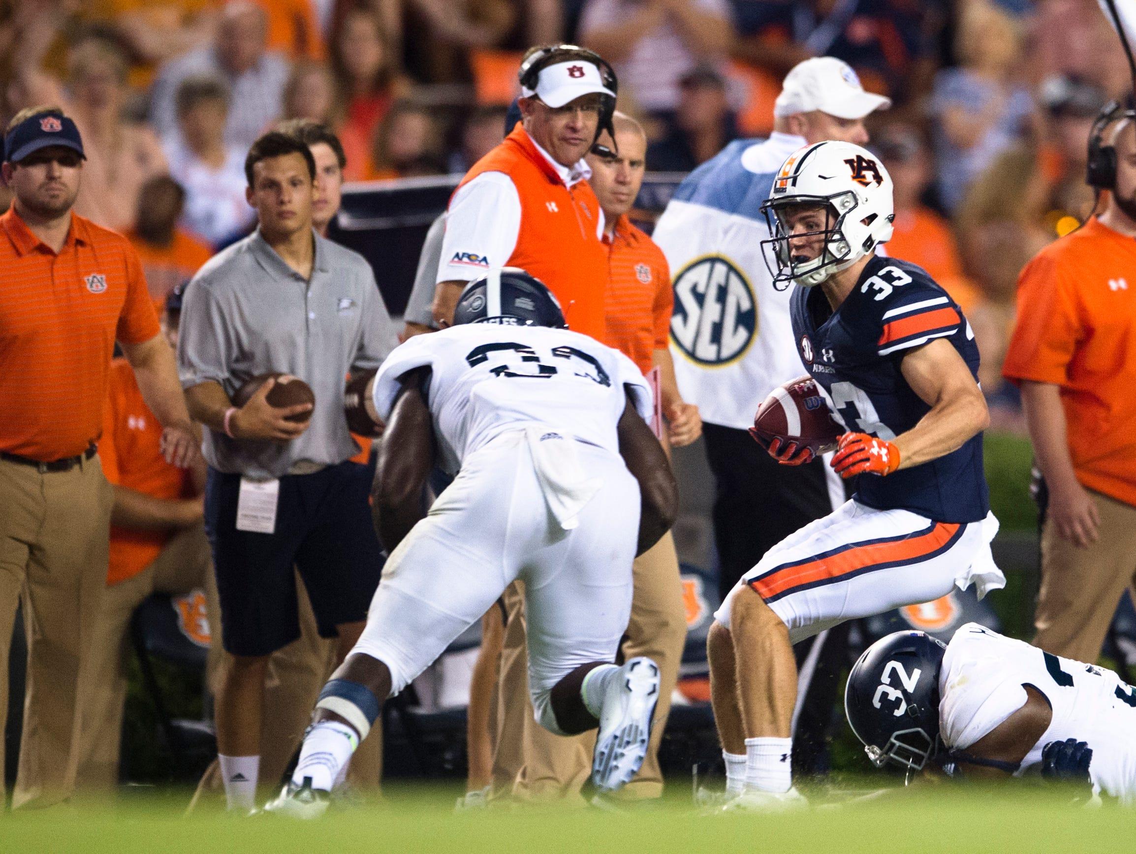 Auburn wide receiver Will Hastings (33) is hit by Georgia Southern linebacker Chris Harris Jr. (32) during the NCAA football game between Auburn vs. Georgia Southern on Saturday, Sept. 2, 2017, at Jordan Hare Stadium in Auburn, Ala.