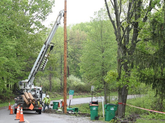 A Central Hudson crew replaces a broken utility pole on Stony Kill Road in Wappingers Falls on May 17, 2018.