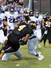 Trenton Peabody's Jarel Dickson (4) is tackled by two