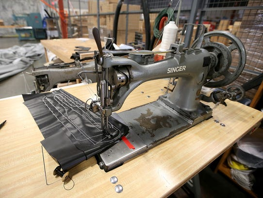 """A Singer sewing machine nicknamed """"Beastmode"""" awaits the next project at Tarp Innovators in Poulsbo."""