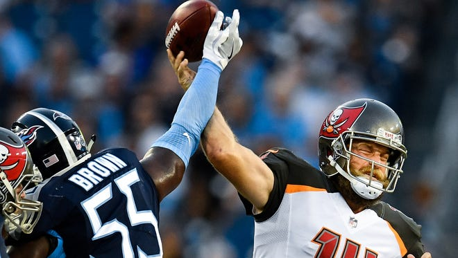 Tennessee Titans linebacker Jayon Brown (55) deflects a throw by Tampa Bay Buccaneers quarterback Ryan Fitzpatrick (14) during the first half at Nissan Stadium in Nashville, Tenn., Saturday, Aug. 18, 2018.