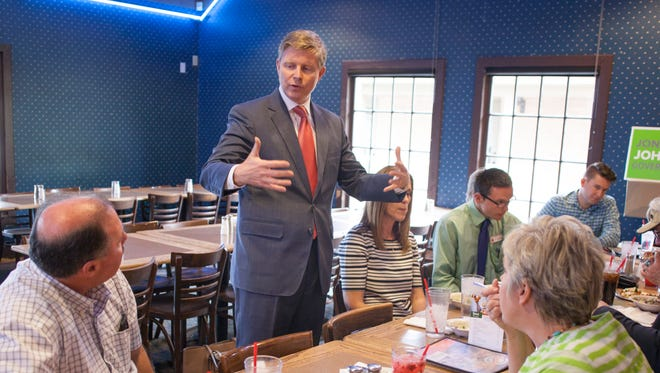 Republican gubernatorial candidate Jonathan Johnson meets with local supporters Friday, May 20, 2016.