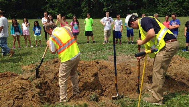 Crews with UtiliQuest and South Jersey Gas help locate and dig for a lost time capsule at Birches Elementary School in Washington Township Monday.