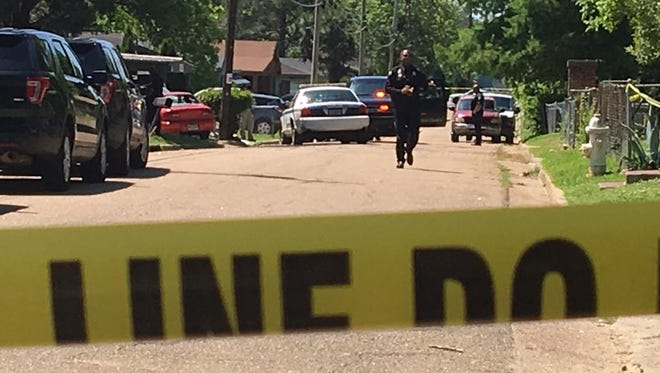 Jackson police on the scene of a fatal shooting.
