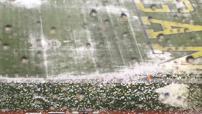 The field at Michigan Stadium is drenched before the Michigan Wolverines and Minnesota Golden Gophers game on Saturday, Nov. 4, 2017. The game's start will be delayed because of lightning.