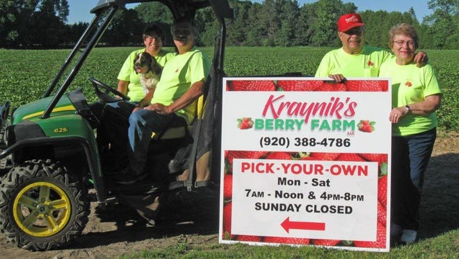 Ken and Judy Kraynik, right, have handed over operations of their Kraynik's Berry Farm in Kewaunee after 38 years running the business to their son and daughter-in-law Todd and Linda Kraynik, at left with their dog Chloe.