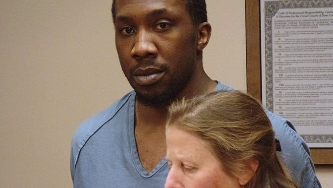 Former University of Wisconsin football player Jack Ikegwuonu appears in court, with lawyer Lisa Goldman in Madison on Tuesday. Ikegwuonu and his twin are facing federal charges in connection with a string of November robberies at five local businesses. The brothers were arrested last week after an armed robbery at a dry cleaning business in Middleton.
