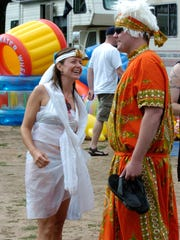 PaddleQuest involves canoeing the back channels of the Wisconsin River, collecting things and competing in challenges. The race is actually a real-life role-playing game, including characters such as those pictured here in this 2007 photo:  Queen Nestra (Lorelei MacBeth) and the Wizaard (Brody Welch).