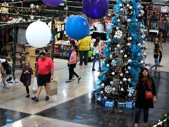 Shoppers make their way to the booths during Christmas