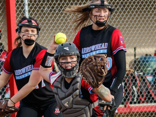 Arrowhead catcher Sydney Rogowski (3) readies a throw to first during the game at home against New Berlin West on Wednesday, March 28, 2018.