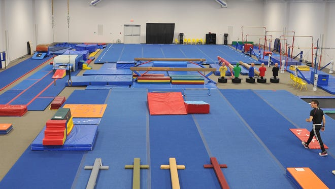 YMCA Gymnastics Director Joe Cronin walks across the newly opened 12,000 square foot Stephens Family Gymnastics Center located at the Bill Bartley YMCA.