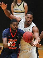 Carson-Newman sophomore forward Parker Role (24) and Anderson freshman center Carlos Dotson (23) reach for a loose ball during the first half on Wednesday in the Abney Athletic Center at Anderson University.