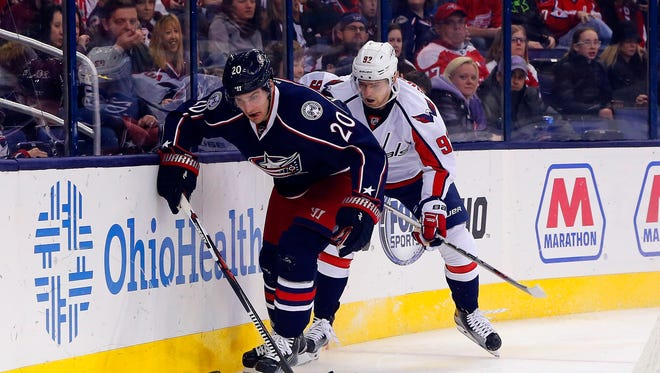 Columbus Blue Jackets left wing Brandon Saad (20) controls the puck as Washington Capitals center Evgeny Kuznetsov (92) trails the play during the second period at Nationwide Arena.