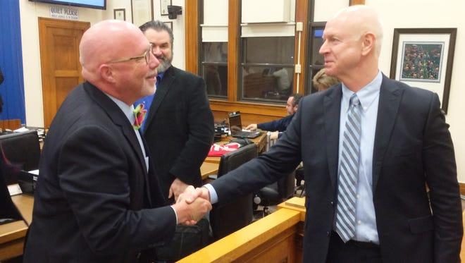 Sheboygan alderman John Belanger, left, gives Darrell Hofland a congratulatory handshake following the Common Council meeting Monday evening. The council unanimously selected Hofland as Sheboygan's next city administrator.