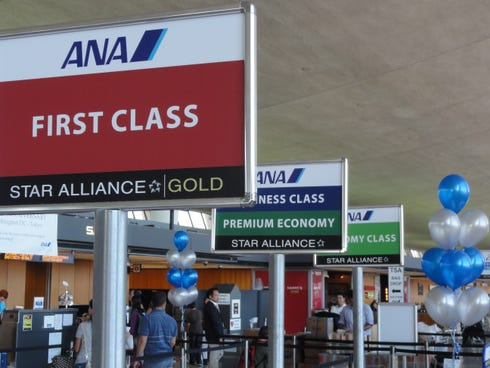 Lines separate check-in sites at the All Nippon Airways counter at Washington Dulles International. Frequent business traveler Herkea Jea says ANA is his favorite airline, with great food and service.