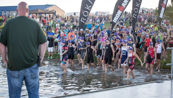 Athletes in different age blocks start of with the Saturday's Ironman 70.3 Muncie at Prairie Creek. The athletes start by swimming 1.2 miles, then bike 56 miles and end by running 13.1 miles.