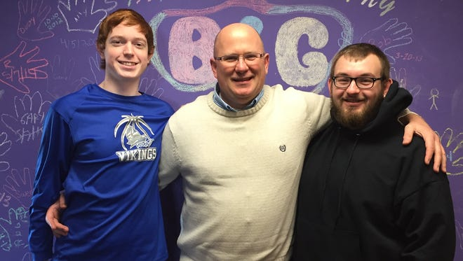 Among the people Mike Owens, middle, has mentored over 25 years are Nathan, left, and Tyler. The Big Brothers Big Sisters program is run by United Way.
