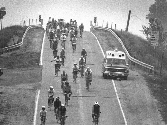 Riders of RAGBRAI XVII bike downhill near Pacific Junction.