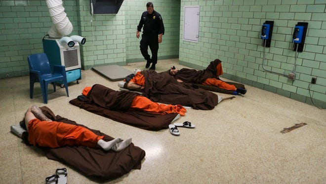 In order to adapt to the overcrowding situation at Louisville Metro Corrections temporary mats and cots have been placed in dorms as the facility's population swells to hundreds above design capacity. A portable air-conditioning unit was placed in to help cool things down.