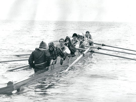 During the perilous crossing of Elliott Bay, four men rowed while four used buckets to bail out water.