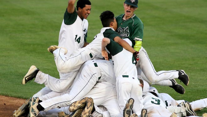 East Brunswick celebrates after defeating the J.P. Stevens in the Greater Middlesex Conference Baseball Tournament championship, held in Bridgewater, NJ  May 27, 2016.