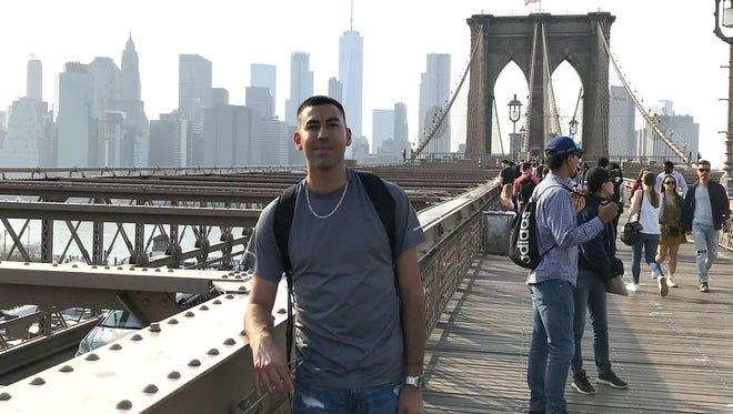Julian Lujan posed for this photo on the Brooklyn Bridge with the New York City skyline in the background. Lujan was a passenger on Southwest Airlines Flight 1380 that made an emergency landing in Philadelphia on Tuesday, April 17, 2018, when a jet engine blew.