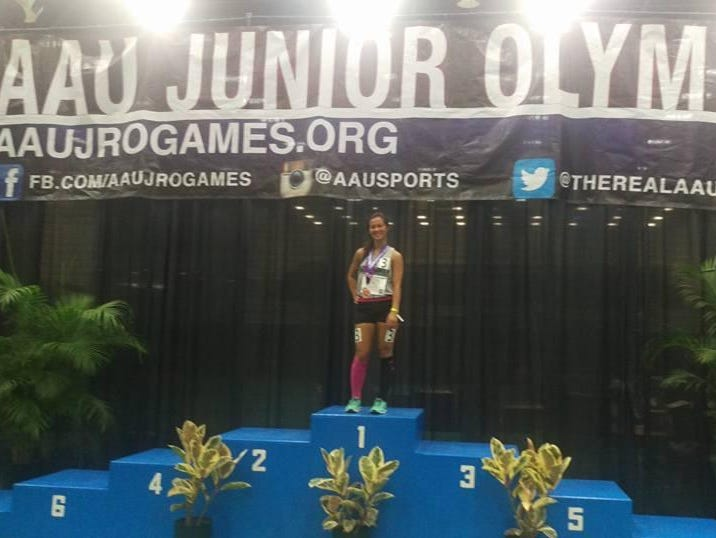 Caroline Mahalak of Westland John Glenn relishes earning a spot on the podium in the race-walk at the AAU Junior Olympics.