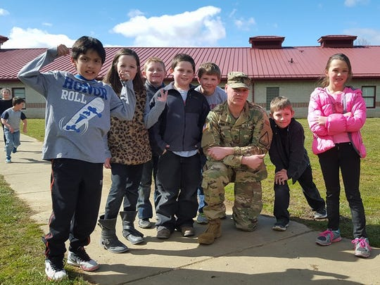 "Clyde Elementary second graders packed and gave cookies to military, firefighters, police and EMS workers as part of the schools ""Cookies for Courage"" program. Pictured are Tevin Ross, Laila Belt, Payton Gunter, Austin Teague, Jeremy Horton, Sgt. 1st Class Jeff Wheeler, Isaiah Anderson and Alana Gilliland."