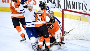 The game-winning goal went off Flyers defenseman Michael Del Zotto, center, and in with 7.5 seconds on the clock.