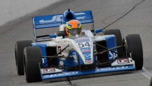Paralyzed racer Michael Johnson fractured his hip and pelvis in Friday's crash in St. Petersburg, Fla.
