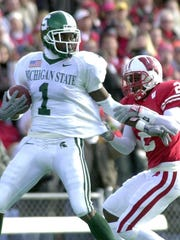 MSU's Charles Rogers (1) breaks away from a Wisconsin defender in this year's game.