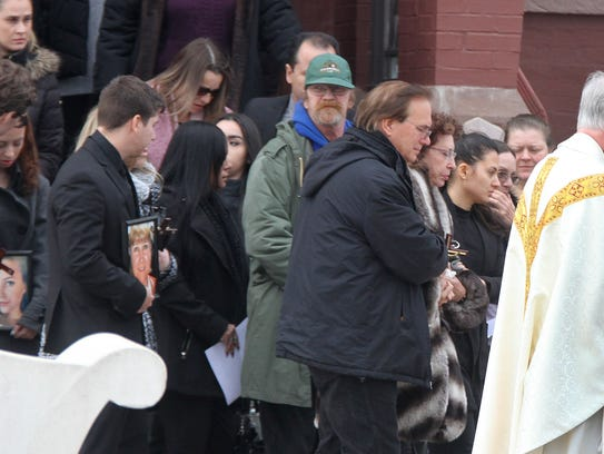 Family members leave St. Michael's Roman Catholic Church in Long Branch, NJ, after the funeral services for Steven Kologi, his wife Linda and daughter Brittany Monday, January 8, 2018. The three were killed on New Year's Eve, along with Mary Ann Schulz, allegedly by a 16-year-old family member.