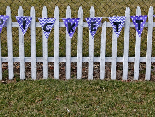 A sign of support is seen on a fence at White Lick Elementary School before the funeral procession of Boone County Deputy Jacob Pickett passes the school in Brownsburg, Friday, March 9, 2018.