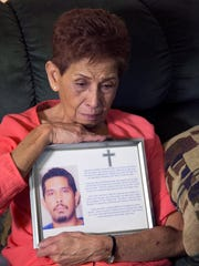 Doris Y. Concepcion holds a photograph May 26, 2016,