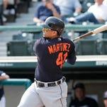 Detroit Tigers designated hitter Victor Martinez bats during 2016 spring training.