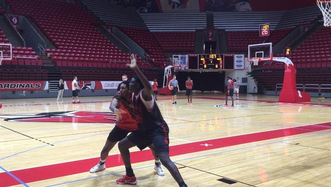 Tahjai Teague defends DouDou Gueye during Ball State's first practice.