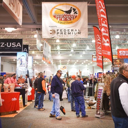 People browse the booths at the 2018 National Pheasant