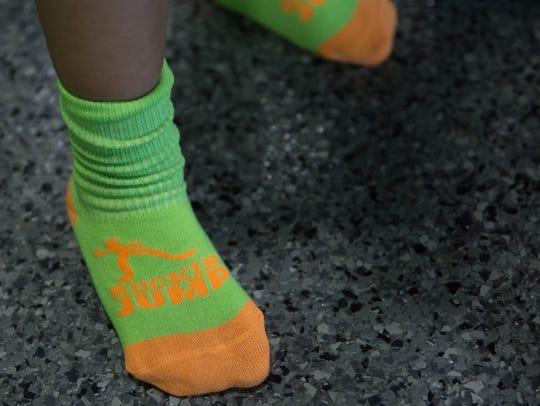 Zane Rodriguez, 3, wears Rockin' Jump socks before