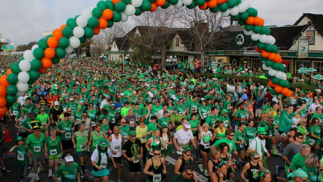 Thousands of people participate in the 38th annual McGuire's St. Patrick's Day 5K Prediction Run Saturday morning.