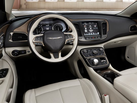 A look inside the 2015 Chrysler 200C shows that the interior was designed to impress, according to auto journalist Casey Williams. Infotainment controls (best in the business) and Jaguar-style rotary gear selector are in a pod beneath the dashboard are just a few of the features.