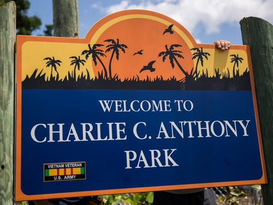 "The corrected park sign reads ""Welcome to Charlie C. Anthony Park""  as it is secured on to the wooden framing on Thursday, April 12, 2018."