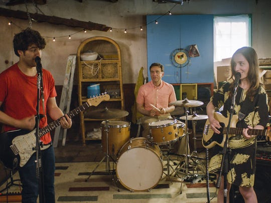 "Adam Pally (from left), Fred Armisen and Zoe Lister-Jones rock out in ""Band Aid."""