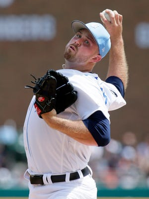 Tigers pitcher Buck Farmer pitches during the third inning of the Tigers' 9-1 loss Sunday at Comerica Park.